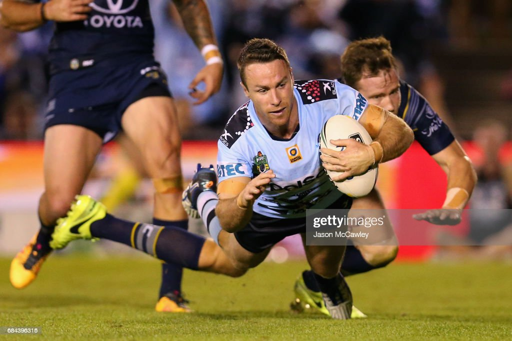 James Maloney of the Sharks scores a try during the round 11 NRL match between the Cronulla Sharks and the North Queensland Cowboys at Southern Cross Group Stadium on May 18, 2017 in Sydney, Australia.