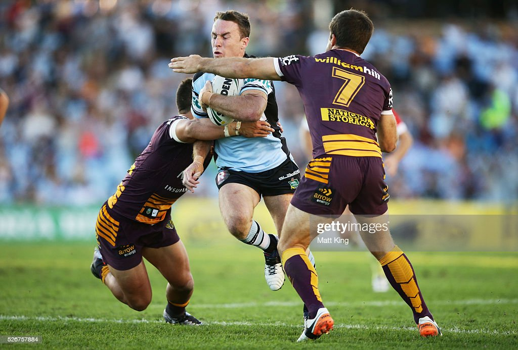James Maloney of the Sharks takes on the defence during the round nine NRL match between the Cronulla Sharks and the Brisbane Broncos at Southern Cross Group Stadium on May 1, 2016 in Sydney, Australia.