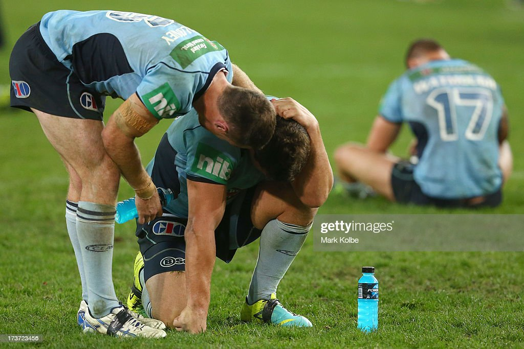 James Malony of the Blues comforts <a gi-track='captionPersonalityLinkClicked' href=/galleries/search?phrase=Greg+Bird+-+Joueur+de+rugby&family=editorial&specificpeople=14983686 ng-click='$event.stopPropagation()'>Greg Bird</a> of the Blues after defeat during game three of the ARL State of Origin series between the New South Wales Blues and the Queensland Maroons at ANZ Stadium on July 17, 2013 in Sydney, Australia.