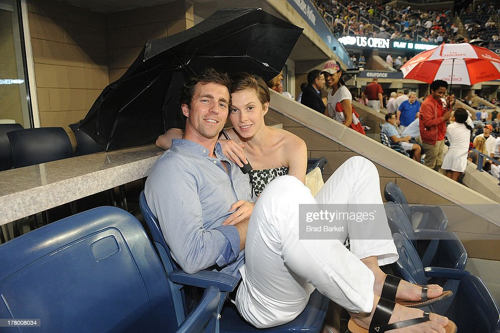 James Marshall (L) and Model Elettra Wiedemann attend he Moet & Chandon Suite at USTA Billie Jean King National Tennis Center on August 26, 2013 in New York City.