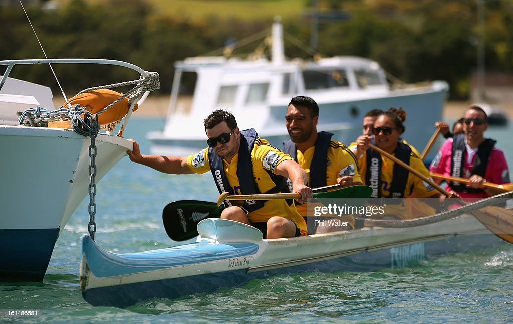 James Marshall (L) and Victor Vito (C) of the Hurricanes push away from a moored boat as they compete in a Wakaama ( outrigger canoe) challenge during the 2013 Super Rugby Season Launch at the Royal Akarana Yacht Club on February 12, 2013 in Auckland, New Zealand.