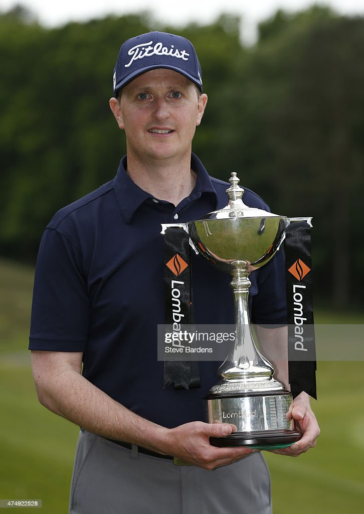 James Marshall of Addington golf club poses with the Lombard Trophy after his victory in the Lombard Trophy South Qualifier at Camberley Heath golf...