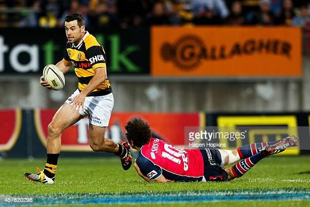 James Marshall of Taranaki evades the tackle of Marty Banks of Tasman during the ITM Cup Premiership Final match between Taranaki and Tasman at...