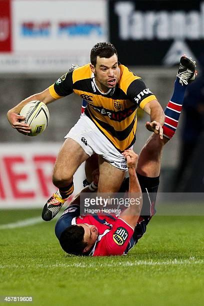 James Marshall of Taranaki is tackled by Tom Marshall of Tasman during the ITM Cup Premiership Final match between Taranaki and Tasman at Yarrow...