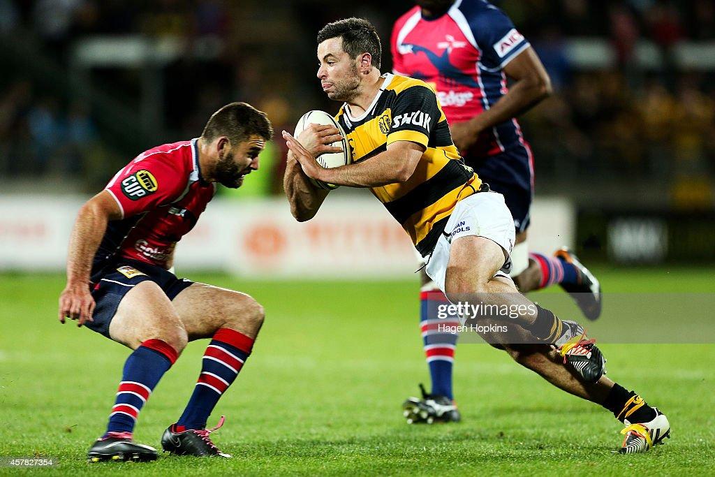 James Marshall of Taranaki runs at Billy Guyton of Tasman during the ITM Cup Premiership Final match between Taranaki and Tasman at Yarrow Stadium on...