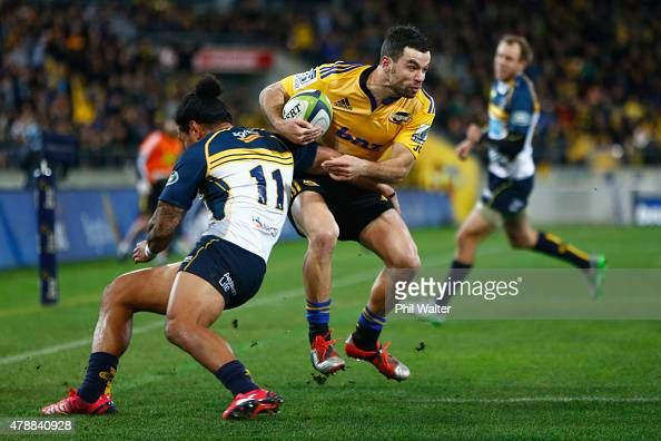 James Marshall of the Hurricanes fends off Joe Tomane of the Brumbies during the Super Rugby Semi Final match between the Hurricanes and the Brumbies...