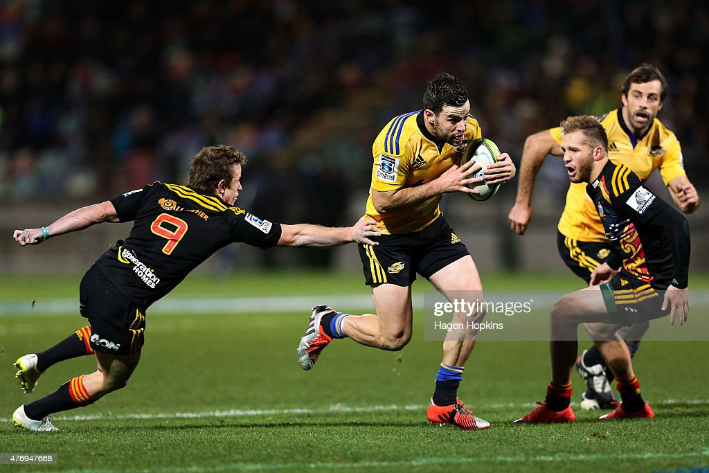 James Marshall of the Hurricanes gets past the defence of Brad Weber of the Chiefs during the round 18 Super Rugby match between the Chiefs and the...