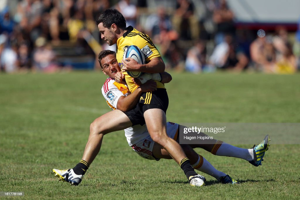 James Marshall of the Hurricanes is tackled by Aaron Cruden of the Chiefs during the Super Rugby trial match between the Hurricanes and the Chiefs at Mangatainoka RFC on February 16, 2013 in Mangatainoka, New Zealand.