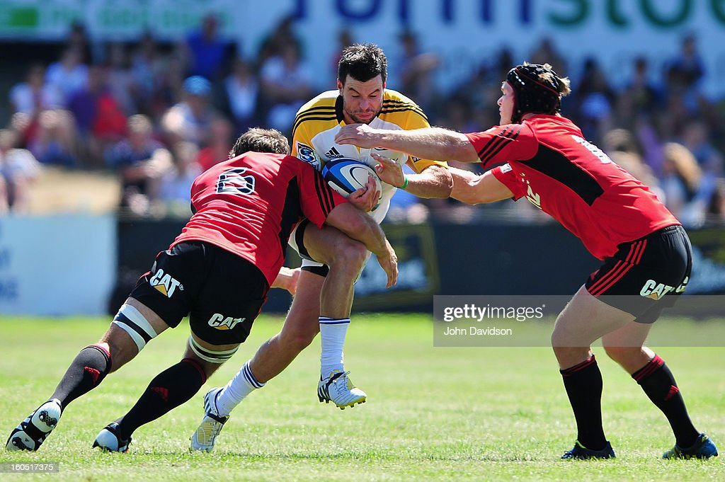 James Marshall of the Hurricanes is tackled by <a gi-track='captionPersonalityLinkClicked' href=/galleries/search?phrase=George+Whitelock&family=editorial&specificpeople=4532140 ng-click='$event.stopPropagation()'>George Whitelock</a> and Tlyer Blyendaal of the Crusaders during the 2013 Super Rugby pre-season friendly match between the Crusaders and the Hurricanes at Alpine Stadium on February 2, 2013 in Timaru, New Zealand.