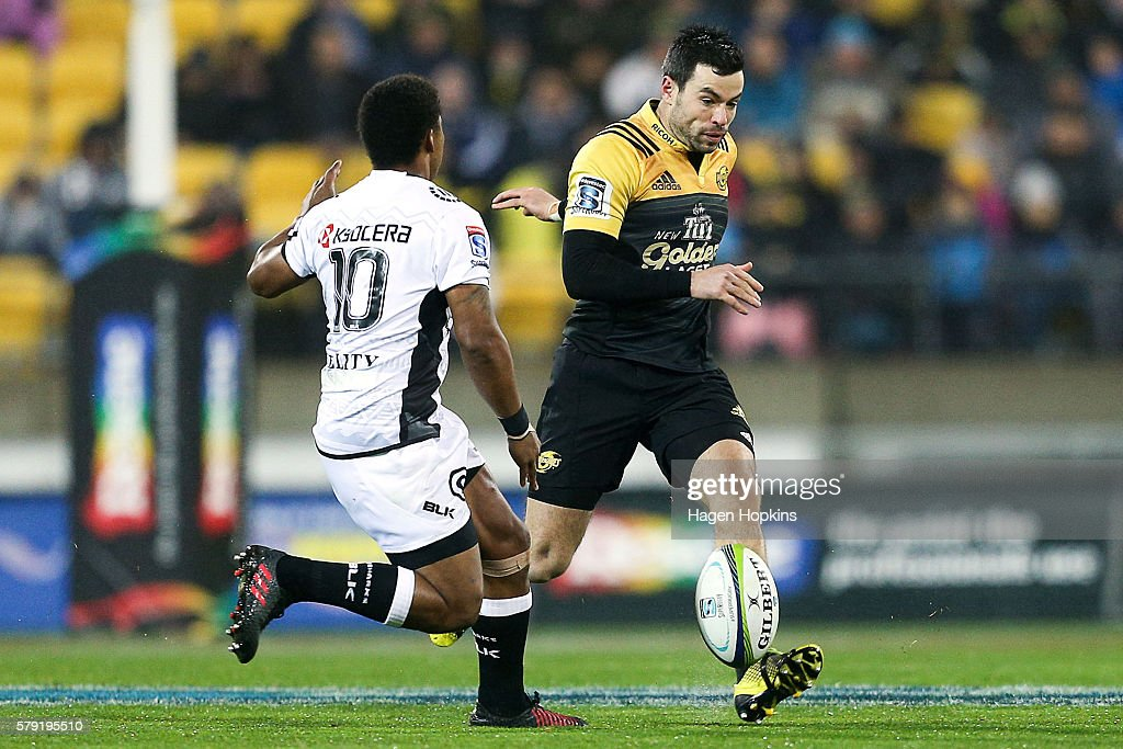 James Marshall of the Hurricanes kicks past Garth April of the Sharks during the Super Rugby Quarterfinal match between the Hurricanes and the Sharks...