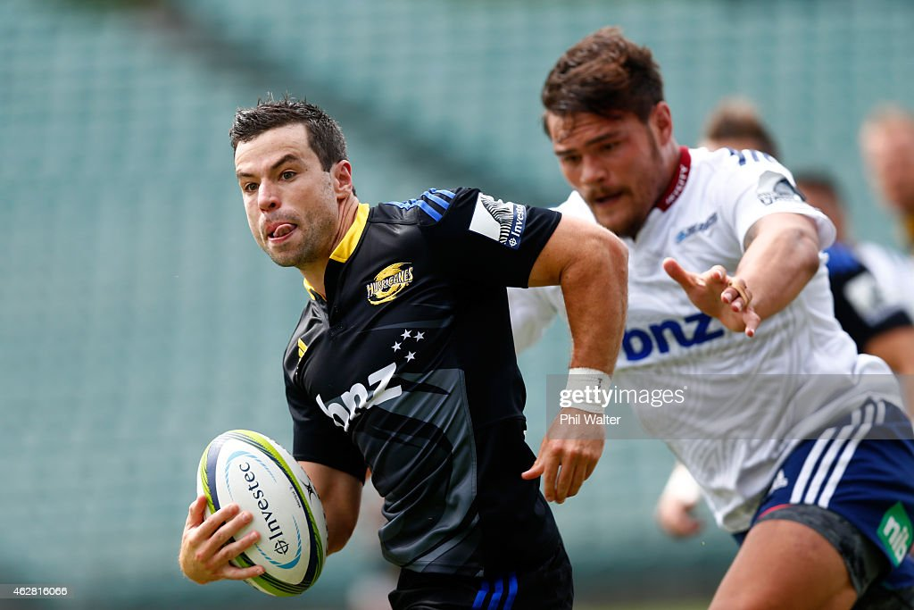 James Marshall of the Hurricanes makes a break away during the Super Rugby preseason match between the Blues and the Hurricanes at QBE Stadium on...
