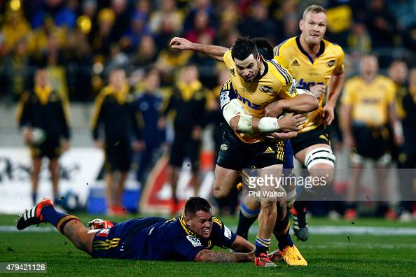 James Marshall of the Hurricanes makes a break during the Super Rugby Final match between the Hurricanes and the Highlanders at Westpac Stadium on...