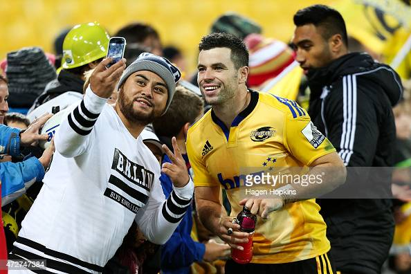 James Marshall of the Hurricanes poses with a fan during the round 13 Super Rugby match between the Hurricanes and the Sharks at Westpac Stadium on...