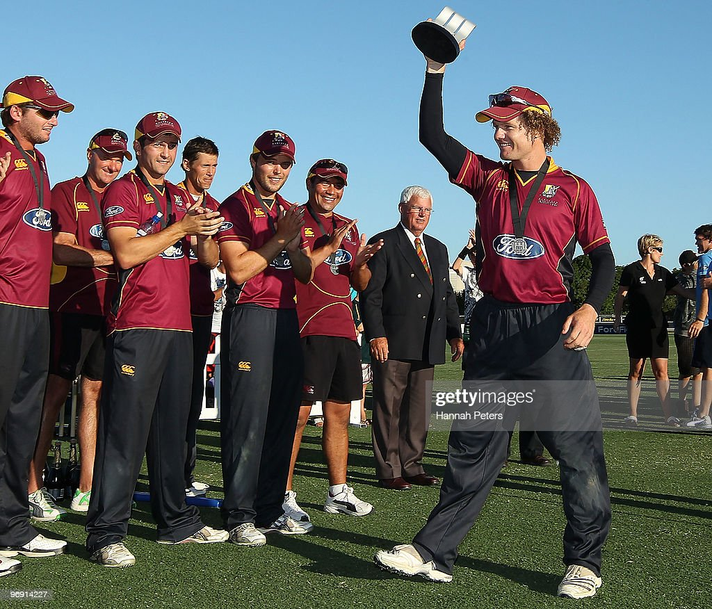 James Marshall of the Knights holds up the ODI trophy after winning the One Day Final match between the Auckland Aces and the Northern Knights at...