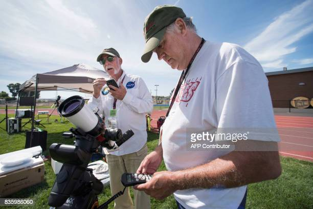 James Martin and Roger Kennedy from Charlie Bates Astronomy Project set up a Lunt solar telescope at the Lowell Observatory Solar Eclipse Experience...