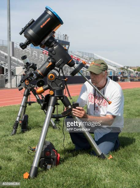 James Martin from Charlie Bates Astronomy Project sets up a Celestron telescope at the Lowell Observatory Solar Eclipse Experience August 20 2017 in...