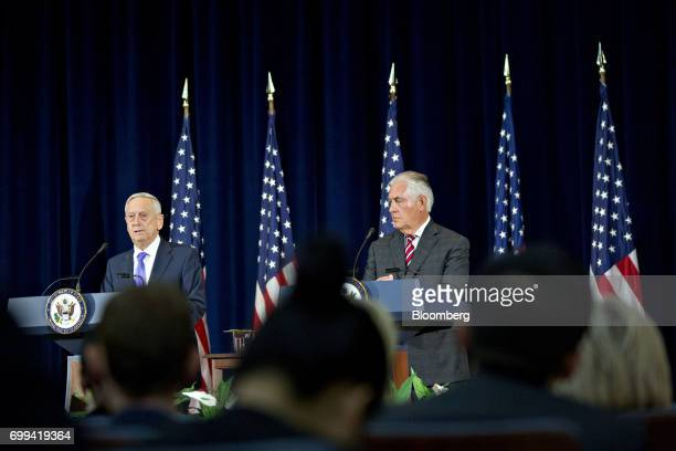 James Mattis US secretary of defense left speaks as Rex Tillerson US secretary of State listens during a news conference following the inaugural...