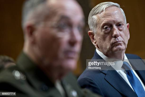 James Mattis US secretary of defense listens as General Joseph Dunford chairman of the US Joint Chiefs of Staff left speaks during a Senate...