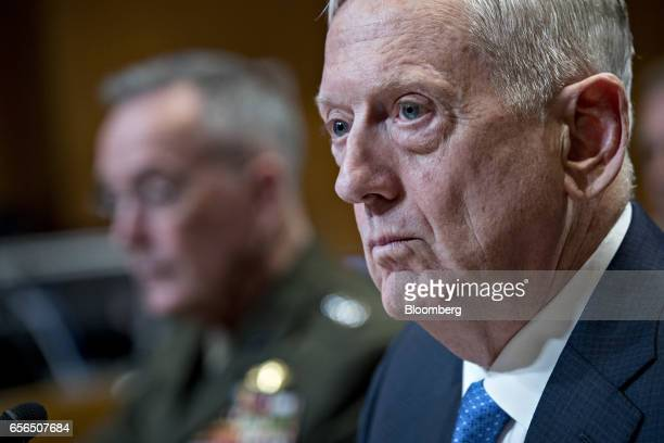 James Mattis US secretary of defense right and General Joseph Dunford chairman of the US Joint Chiefs of Staff listen during a Senate Appropriations...