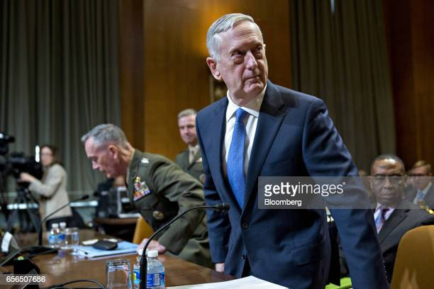 James Mattis US secretary of defense right and General Joseph Dunford chairman of the US Joint Chiefs of Staff take a seat during a Senate...