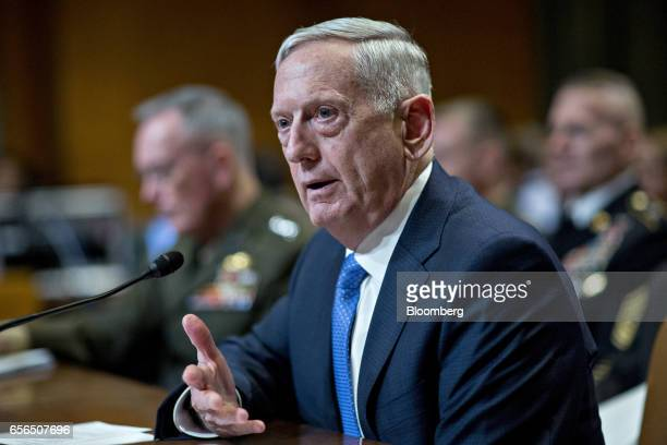 James Mattis US secretary of defense speaks as General Joseph Dunford chairman of the US Joint Chiefs of Staff left listens during a Senate...