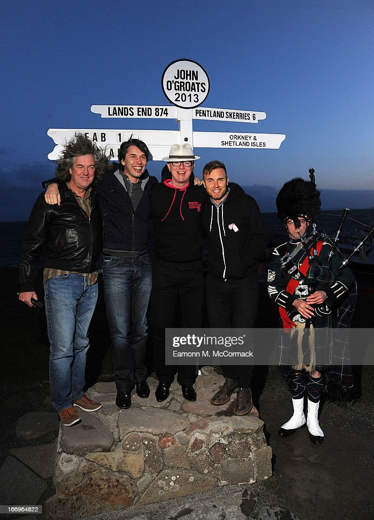 James May, Professor Brian Cox, Chris Evans and Gary Barlow complete the FAB1 Million drive from Land's End to John O'Groats on April 19, 2013 in John O'Groats, Scotland. FAB1 Million aims to raise one million pounds for Breast Cancer Care using a bespoke pink Rolls Royce Ghost with the original FAB1 Thunderbirds number plate, which is available for hire.