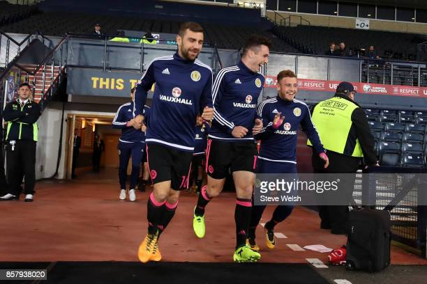 James McArthur John McGinn and Ryan Fraser of Scotland run onto the pitch prior to during the FIFA 2018 World Cup Group F Qualifier between Scotland...