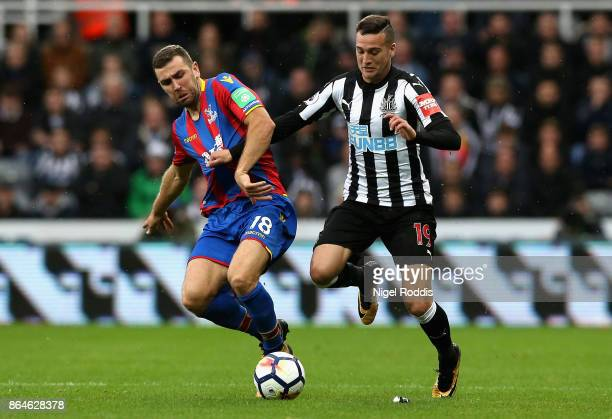 James McArthur of Crystal Palace and Javi Manquillo of Newcastle United tussle for the ball during the Premier League match between Newcastle United...
