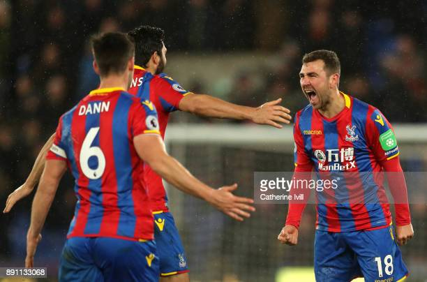 James McArthur of Crystal Palace celebrates after scoring his sides second goal with teammates during the Premier League match between Crystal Palace...