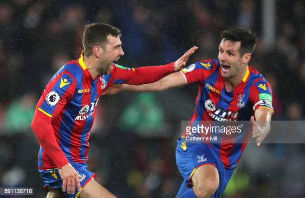 James McArthur of Crystal Palace celebrates after scoring his sides second goal with teammate Scott Dann during the Premier League match between...