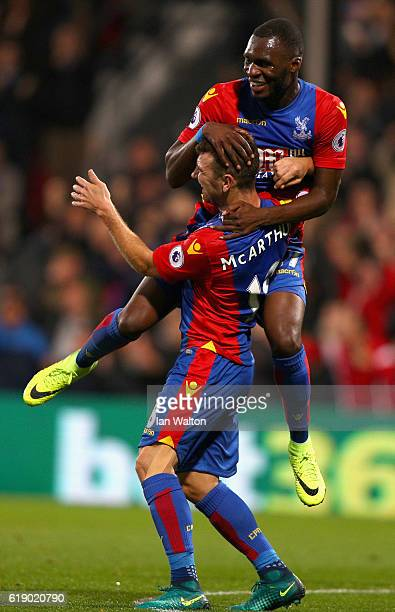 James McArthur of Crystal Palace celebrates scoring his team's first goal with his team mate Christian Benteke during the Premier League match...