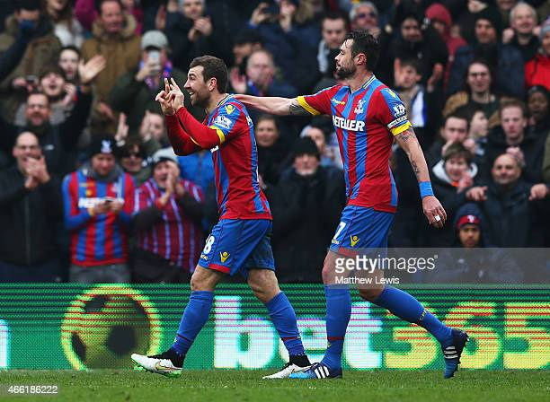 James McArthur of Crystal Palace celebrates scoring his team's second goal with Damien Delaney during the Barclays Premier League match between...