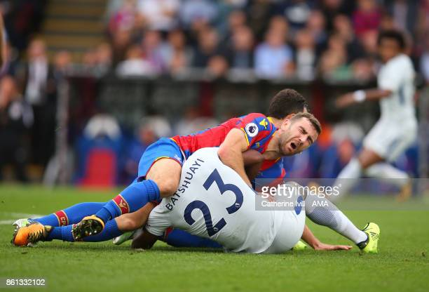 James McArthur of Crystal Palace gets caught up with Michy Batshuayi of Chelsea during the Premier League match between Crystal Palace and Chelsea at...