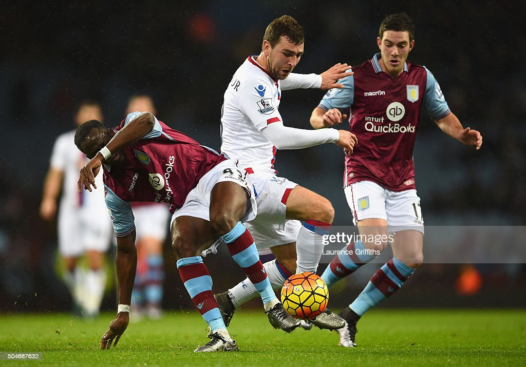 James McArthur of Crystal Palace goes between Aly Cissokho and Jordan Veretout of Aston Villa during the Barclays Premier League match between Aston Villa and Crystal Palace at Villa Park on January 12, 2016 in Birmingham, England.