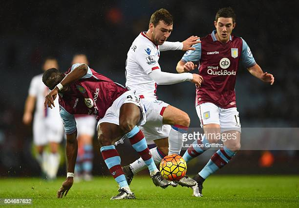 James McArthur of Crystal Palace goes between Aly Cissokho and Jordan Veretout of Aston Villa during the Barclays Premier League match between Aston...