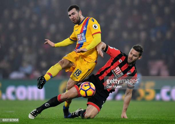 James McArthur of Crystal Palace is tackled by Simon Francis of AFC Bournemouth during the Premier League match between AFC Bournemouth and Crystal...