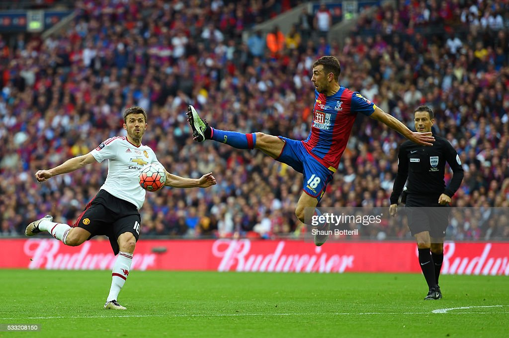 James McArthur of Crystal Palace jumps to block Michael Carrick of Manchester United during The Emirates FA Cup Final match between Manchester United...