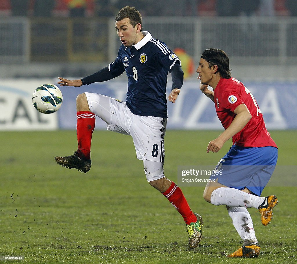 James McArthur (L) of Scotland in action against Ljubomir Fejsa (R) of Serbia during the FIFA 2014 World Cup Qualifier between Serbia and Scotland at Karadjordje Stadium on March 26, 2013 in Novi Sad, Serbia
