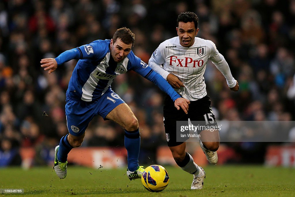 James McArthur of Wigan and <a gi-track='captionPersonalityLinkClicked' href=/galleries/search?phrase=Kieran+Richardson+-+Soccer+Player&family=editorial&specificpeople=208833 ng-click='$event.stopPropagation()'>Kieran Richardson</a> of Fulham compete for the ball during the Barclays Premier League match between Fulham and Wigan Athletic at Craven Cottage on January 12, 2013 in London, England.