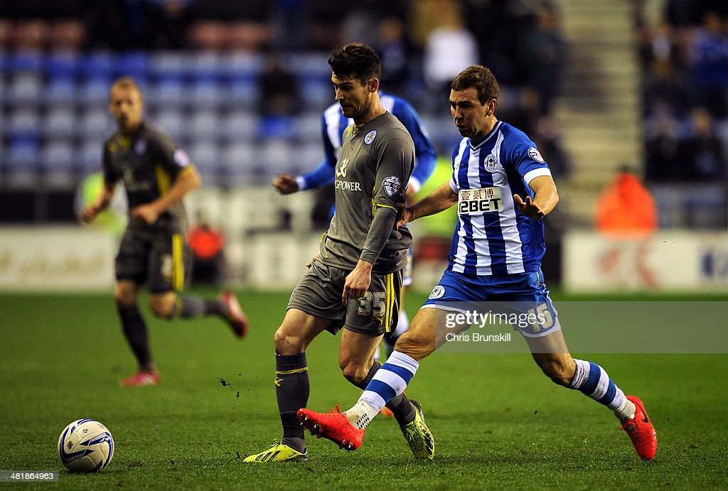 James McArthur of Wigan Athletic challenges David Nugent of Leicester City during the Sky Bet Championship match between Wigan Athletic and Leicester City at DW Stadium on April 01, 2014 in Wigan, England.