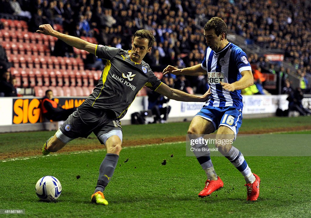 James McArthur (R) of Wigan Athletic in action with <a gi-track='captionPersonalityLinkClicked' href=/galleries/search?phrase=Andy+King+-+Soccer+Player+-+Born+1988&family=editorial&specificpeople=14622523 ng-click='$event.stopPropagation()'>Andy King</a> of Leicester City during the Sky Bet Championship match between Wigan Athletic and Leicester City at DW Stadium on April 01, 2014 in Wigan, England.