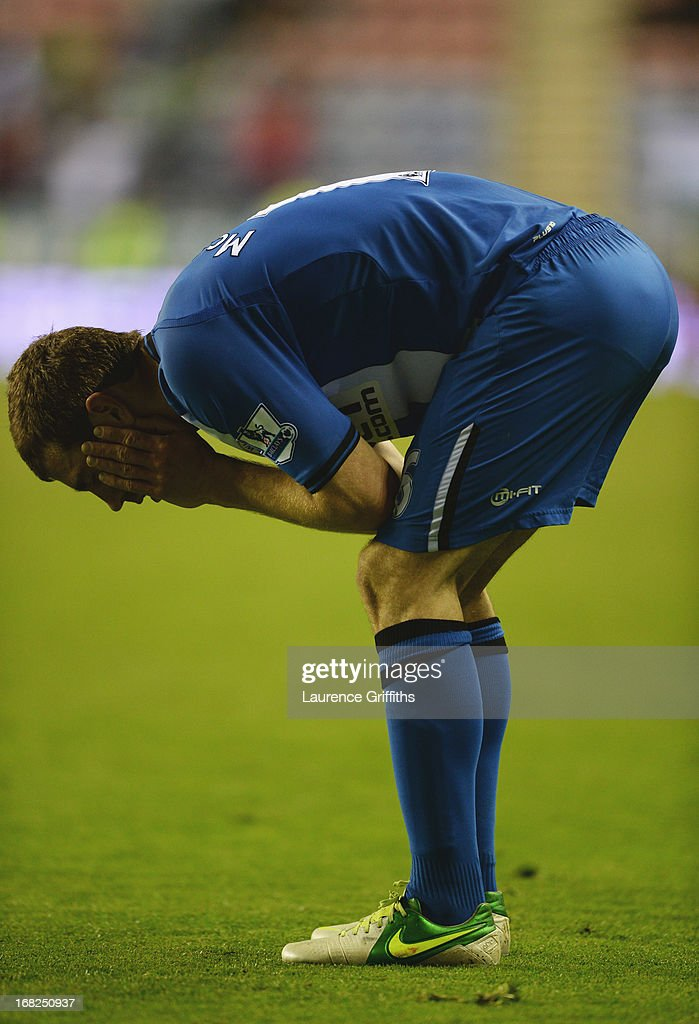 James McArthur of Wigan Athletic looks dejected after defeat during the Barclays Premier League match between Wigan Athletic and Swansea City at DW Stadium on May 7, 2013 in Wigan, England.