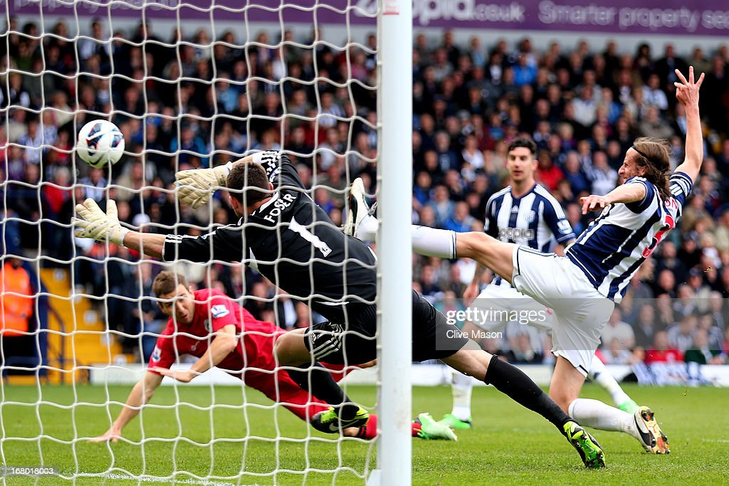 James McArthur (L) of Wigan scores his team's second goal despite the efforts from goalkeeper Ben Foster and Jonas Olsson of West Bromwich during the Barclays Premier League match between West Bromwich Albion and Wigan Athletic at The Hawthorns on May 4, 2013 in West Bromwich, England.