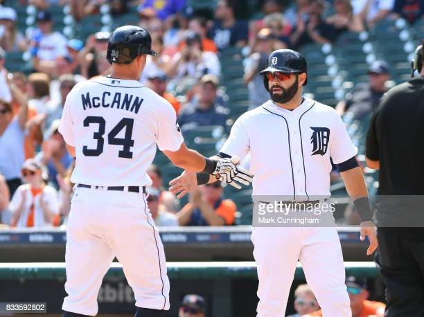 James McCann and Alex Avila of the Detroit Tigers shake hands during the game against the Houston Astros at Comerica Park on July 30 2017 in Detroit...