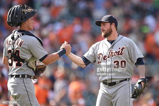 James McCann and Alex Wilson of the Detroit Tigers celebrate a win after a baseball game against the Baltimore Orioles at Oriole Park at Camden Yards...