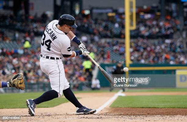 James McCann of the Detroit Tigers bats against the Texas Rangers at Comerica Park on May 19 2017 in Detroit Michigan