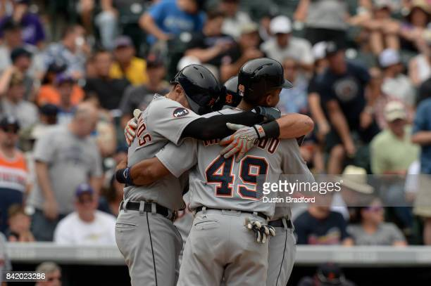 James McCann of the Detroit Tigers celebrates at home plate with Dixon Machado and Nicholas Castellanos after hitting a fifth inning three run...