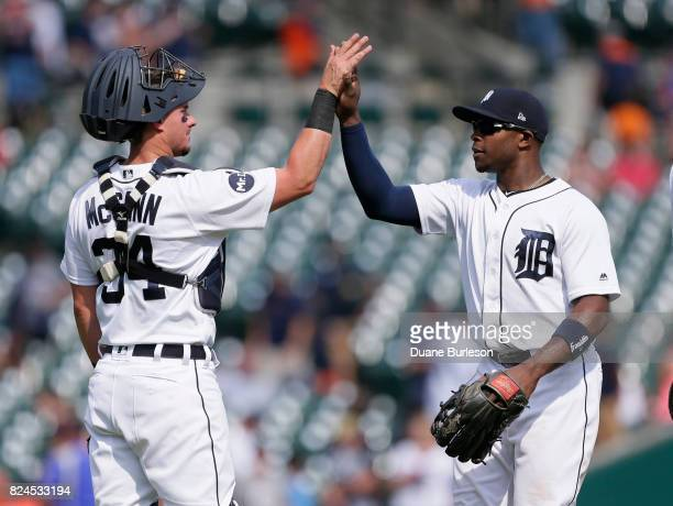 James McCann of the Detroit Tigers celebrates with Justin Upton of the Detroit Tigers after a win over the Houston Astros at Comerica Park on July 30...