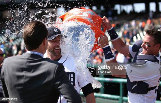 James McCann of the Detroit Tigers dumped water on teammate Andrew Romine during the post game interviews after the game against the Minnesota Twins...