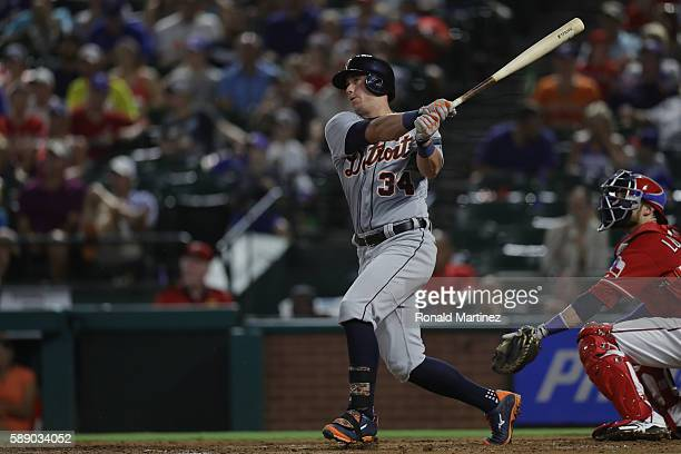 James McCann of the Detroit Tigers hits a one run double against the Texas Rangers in the second inning at Globe Life Park in Arlington on August 12...